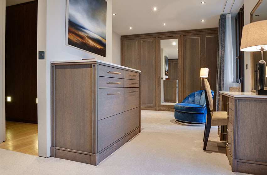 master dressing room with wardrobes and chest of drawers