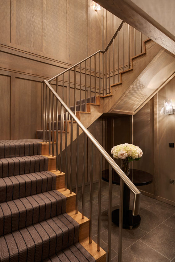 wooden staircase with wooden panelling