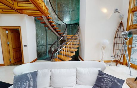 curved staircase in living room