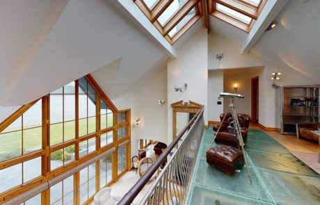 staircase railing overlooking living room