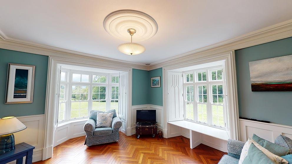living room wooden shutters and herringbone floor